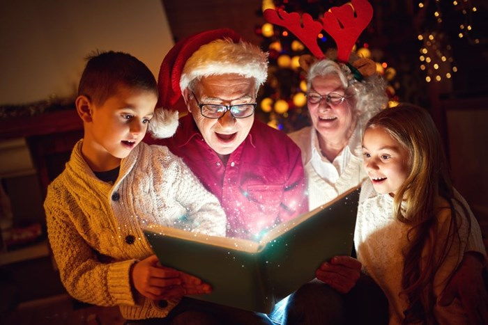 family reading a Christmas book