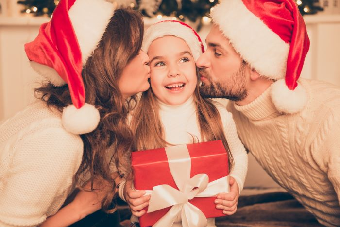 Child and parents at Christmas